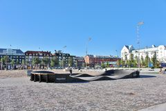 Southern port in Luleå. On the south beach there is a kiosk, sandy beach, seating furniture and umbrella, barbecue areas, concrete ping pong table, volleyball stock images