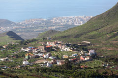Southern side of Tenerife island with small villages at mountains slopes and the Atlantic coast, aerial view from mirador. Canary Stock Photography