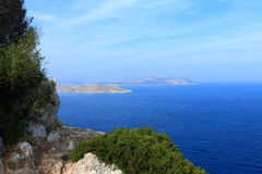 Southern Sporades. View on Makry and Strongyli. Seascape near Kritinia in sunny weather with light cirrus clouds in the sky. The coast of the Aegean Sea. Rhodes Stock Images