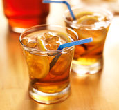 Southern sweet tea with lemon slices and straws Stock Images