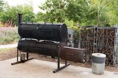 Southern Texas BBQ Smoker. Southerny style smoker bbq in Texas where the cook is smoking some meat for a big dinner celebration Royalty Free Stock Photography
