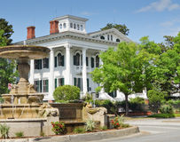 Bellamy mansion with fountain on side. royalty free stock image