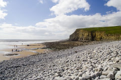 Southerndown Cliffs and People. Figures on the sand enjoying the coastline on a bright spring day stock photos