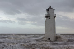 Southerness Lighthouse in stormy seas Royalty Free Stock Photo