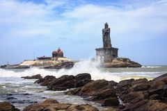 Southernmost tip of peninsular India, Kanyakumari. The southernmost tip of peninsular India. Waves crashing against the rocks with the background of Vivekananda stock images