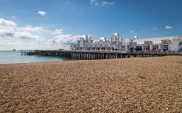 Southsea Pier. With shingle beach and clouded sky Stock Photos