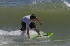 Southside Shootout Skimboard Competition. Skimboarder rides a wave during the 2014 Southside Shootout 2014  skimboard competion at Delaware Seashore State Park Stock Photography