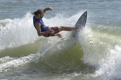 Southside Shootout Skimboard Competition. Skimboarder rides a wave during the 2014 Southside Shootout 2014  skimboard competion at Delaware Seashore State Park Stock Images