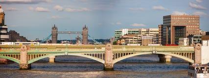 Southwark Bridge across River Thames, London, England. Southwark Bridge and Tower Bridge obscuring London Bridge between them royalty free stock image