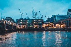 Southwark Bridge and Cranes on Thames Waterfront Royalty Free Stock Photo