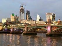 Southwark Bridge and London City Skyline. This is a picute of Southwark Bridge in London at Sunset stock images