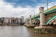 Southwark Bridge London England. The Southwark bridge over Thames river in London, England stock images