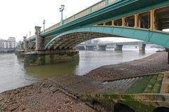 Southwark Bridge London. Southwark Bridge Over Low Tide River Thames in London stock photo