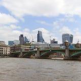 Southwark Bridge and modern glazed, office buildings, Business center, London, United Kingdom. LONDON, UNITED KINGDOM - JUNE 22, 2017: Southwark Bridge and Royalty Free Stock Photo
