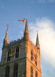 Southwark Cathedral. Low angle view of the steeple of Southwark cathedral on the south bank of the River Thames stock image