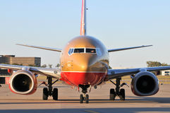 A Southwest Airlines airplane pulling into the gat royalty free stock images