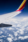 Southwest Airlines Airplane wing with clouds Royalty Free Stock Photos