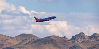 Free Southwest Airlines Boeing 737 Climbing Over The Mountains On Departure From McCarran International Airport In Las Vegas Stock Images - 155185754