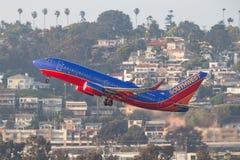 Southwest Airlines Boeing 737-7H4 N426WN som avgår San Diego International Airport Fotografering för Bildbyråer
