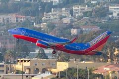 Southwest Airlines Boeing 737-7H4 N920WN som avgår San Diego International Airport Fotografering för Bildbyråer