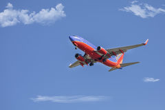 Southwest Airlines Boeing 737 Jet. A Southwest Airlines jet is ready to make a landing, with its landing gear down Stock Photo
