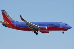 Southwest Airlines flygplan över SLAPPT Arkivbild