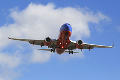 Southwest Airlines jet descending for landing San Diego International Airport. Royalty Free Stock Image