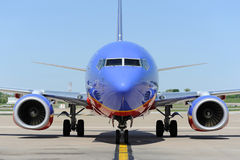 A Southwest Airlines pullint into the gate Stock Photography