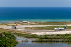 Southwest Airlines and Spirit Airlines aircraft taxiing in Montego Bay. Montego Bay, Jamaica - March 27 2015: Southwest Airlines and Spirit Airlines aircraft royalty free stock photography