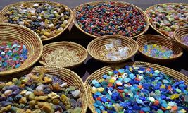 SOUTHWEST BASKETS OF COLORED BEADS AND TILES stock images