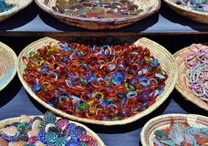 SOUTHWEST BASKETS OF COLORED BEADS AND TILES stock photos