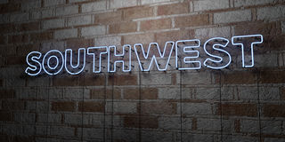 SOUTHWEST - Glowing Neon Sign on stonework wall - 3D rendered royalty free stock illustration Royalty Free Stock Photos