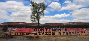 Southwest Landscape with Highway Shop at the Continental Divide. Southwest Landscape at the Continental Divide with highway shop, mesa, blue sky and clouds Stock Photos