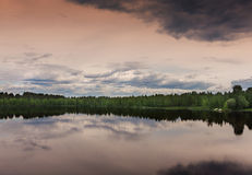 Southwest Lapland in Finland: midsummer evening over the lake. Stock Photos