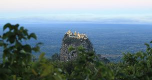 Southwest of Mount Popa is Taung Kalat pedestal hill stock video footage