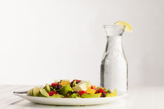 Southwest Salad next to old milk jug filled with water Royalty Free Stock Image