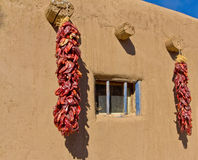 Southwestern Adobe Dwelling and Chilies royalty free stock photo