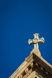 Southwestern architecture. Close up of a Christian cross on top of a church with the traditional southwestern architecture Stock Image