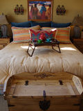 Southwestern Bed Room. Master bed room with a southwestern decor with bold colors of red and blue Royalty Free Stock Image