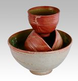 Southwestern bowls. Three southwestern style bowls stacked inside of a much larger bowl Royalty Free Stock Image