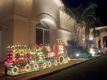 Southwestern Christmas Decorated House. Large southwestern style house decorated for Christmas - oblique view Royalty Free Stock Photo
