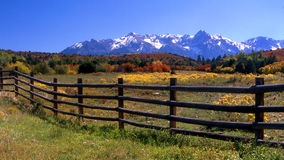 Southwestern Colorado. Wooden fence and the San Juan Mountains Royalty Free Stock Image