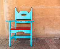 Southwestern design chair. Sidewalk chair, adobe wall and Southwestern design seating stock photos