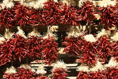 Southwestern Marketplace. Traditional ristra chili peppers hanging in a Santa Fe, New Mexico marketplace royalty free stock photography