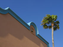 Southwestern Mexican Architecture. Southwest Mexican Architecture with blue sky and palm tree Stock Photography