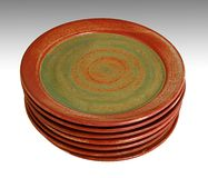Southwestern saucers. A stack of seven southwestern style plates Royalty Free Stock Photography