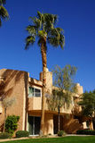 Southwestern style hotel buildings. In green oasis with Palm trees, Rancho Mirage, California royalty free stock image