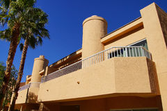 Southwestern style hotel buildings. RANCHO MIRAGE, CALIFORNIA - DEC 16, 2015 - Southwestern style hotel buildings in green oasis with Palm trees, Rancho Mirage stock photography