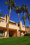 Southwestern style hotel buildings. RANCHO MIRAGE, CALIFORNIA - DEC 16, 2015 - Southwestern style hotel buildings in green oasis with Palm trees, Rancho Mirage royalty free stock photos