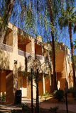 Southwestern style hotel buildings. RANCHO MIRAGE, CALIFORNIA - DEC 16, 2015 - Southwestern style hotel buildings in green oasis with Palm trees, Rancho Mirage stock image